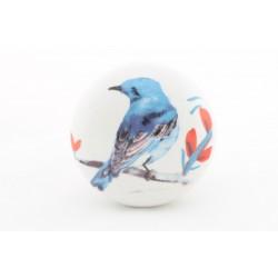 Biały uchwyt z niebieskim ptakiem