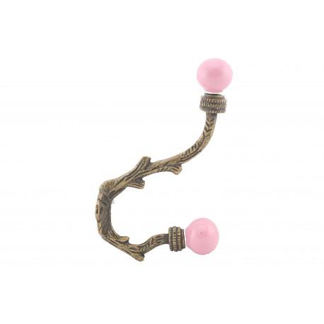 Stylowy hak na ubrania z różowymi gałkami