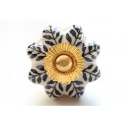 Biało-czarne ceramiczne gałki złote okucia